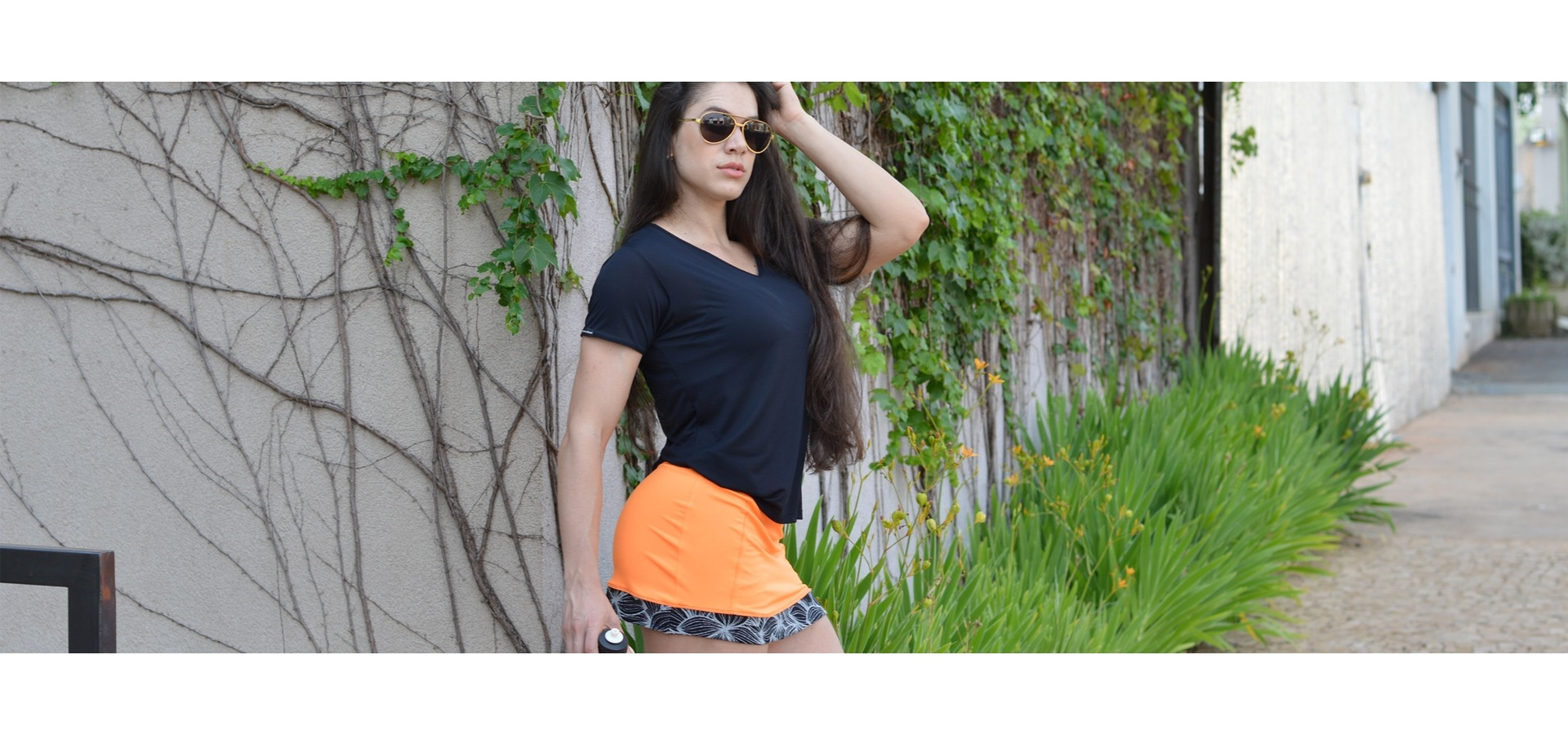 Saia short fitness com detalhe floral-Laranja